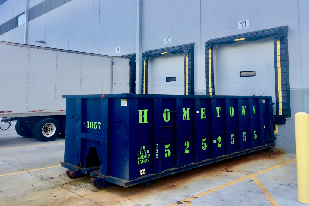 commercial-dumpster-in-front-of-warehouse-dock