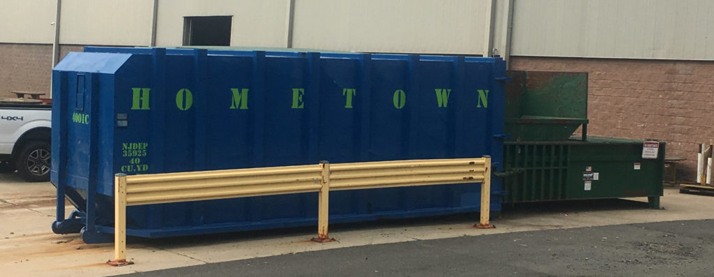 banner-of-hometown-nj-trash-compactor-at-business