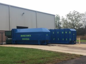 two-large-hometown-waste-trash-compactors-at-new-jersey-warehouse