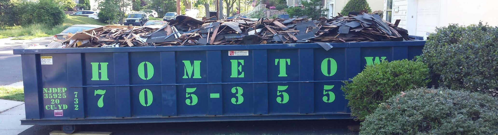 overfilled dumpster with roofing